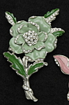 Click here to enlarge image and see more about item f105: Enameled flower brooch