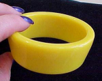 Tapered yellow plastic bangle