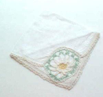Hand crocheted handkerchief with flower design