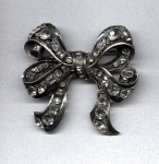 Pot metal and rhinestone bow pin