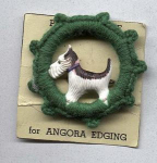 1950's plastic scottie dog pin in ship wheel
