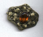 Art Nouveau sash pin with topaz glass stone
