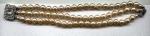 Triple strand faux pearl bracelet