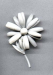 white metal flower pin