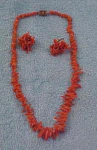 Click here to enlarge image and see more about item f2932: Coral Necklace and earrings