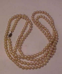 Strand of faux pearls 58