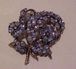 Hollycraft lt blue rhinestone pin 1953