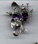 Silver bird ppin with glass stones