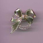 Sterling vermeil bow pin with rhinestones