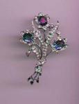 Trifari retro floral pin with enameling and clear rhinestone accents