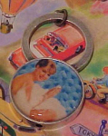 Click here to enlarge image and see more about item f4073: Pin up girl wearing bath bubbles keyring