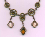 Czechoslovakian brass necklace with topaz glass stones and it has two cameos dangling from the necklace.  15