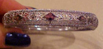 Art deco filligree bangle w/amethyst glass