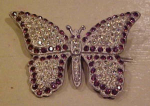 Click here to enlarge image and see more about item f4382: Pot metal and rhinestone butterfly pin