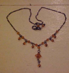 Necklace with topaz colored beads