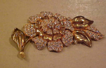 Goldtone flower pin with rhinestones