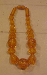 Click to view larger image of Carved applejuice bakelite necklace (Image1)