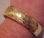 Gold filled hinged bangle w/rose design