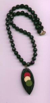 Black faceted plastic bead necklace with bake