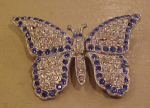 Click here to enlarge image and see more about item f5145: Pot metal and rhinestone butterfly pin