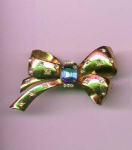 Coro Retro style bow pin with sapphire glass stone and clear rhinestones