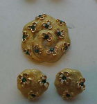 Trifari pin & earrings with green rhinestones