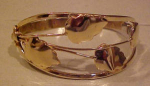 goldtone bangle with leaf design
