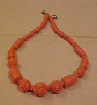 Coral colored celluloid necklace