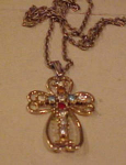 Rhinestone cross on necklace
