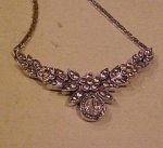 Floral design necklace with rhinestones