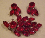 Click here to enlarge image and see more about item f5572: Red rhinestone pin and earrings