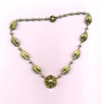 Art Nouveau style necklace with floral deisgn and faux pearls