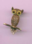 Silver owl pin with tiger's eye eyes and enameling