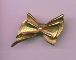 BSK goldtone bow pin