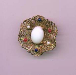Click here to enlarge image and see more about item f697: Hobe goldtone pin with white, red and blue glass cabachons