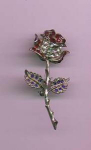 Silvertone metal flower pin with red, clear and blue rhinestones