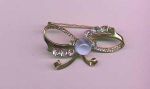 Mazer sterling retro bow pin with blue glass cabachon and clear rhinestones