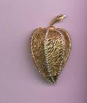 BSK goldtone and rhinestone leaf pin