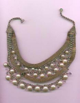 Click to view larger image of 1950's festoon style necklace with aurora borealis rhinestones and faux pearls. (Image1)