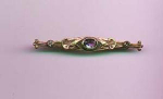 Art Nouveau bar pin with amethyst glass stones
