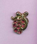 pink and clear rhinestone pin with bow design