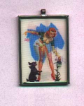 Click here to enlarge image and see more about item f934: Pin up girl 3d medallion necklace