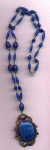 Czechoslovakian necklace with milky blue glass beads and blue glass pendant with blue rhinestone accents.