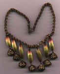 Art Deco style necklace. Ornate chain with 7 dangles with ornate drops