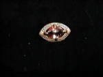 Click here to enlarge image and see more about item l263t: Art Nouveau pin -brass with topaz glass center stone