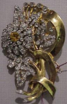 Goldtone flower rhinestone brooch