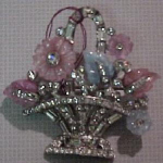 molded glass and rhinestone flower basket bro
