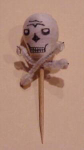 Click here to enlarge image and see more about item skull: 1940's Halloween skull toothpick