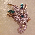 Floral design pin w/green & Cl rhinestones