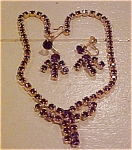 Click here to enlarge image and see more about item x1040: Purple rhinestone necklace and earrings